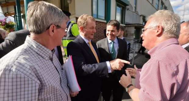 Taoiseach Enda Kenny speaking to Joe Dowling from the Hope Project and Terry Fagan of the North Inner City Folklore Project after meeting with local community groups to discuss new measures for north inner city Dublin. Photograph: Alan Betson/The Irish Times